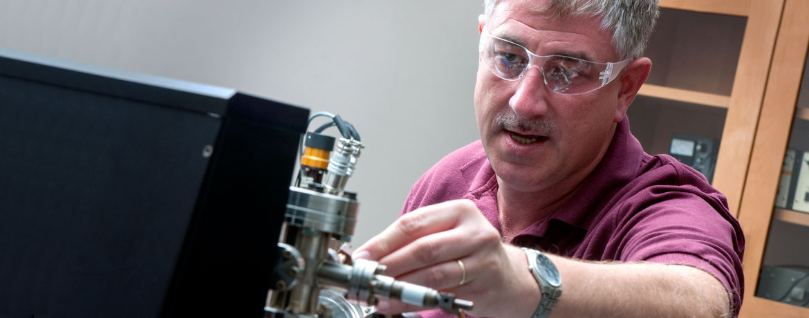 researcher conducting an electrical experiment