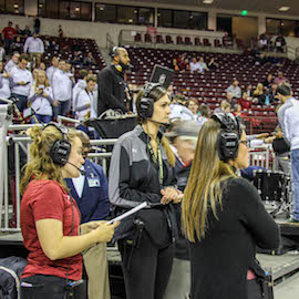 Students working at Colonial Life Arena during a South Carolina basketball game