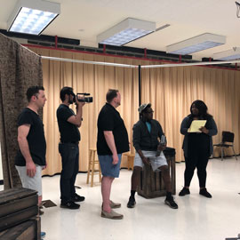 Cast of Armida practices for the show.