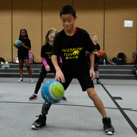 students exercise with a ball