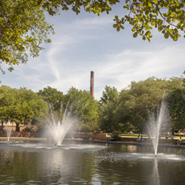 The USC smokestack rises above the Thomas Cooper Library fountain